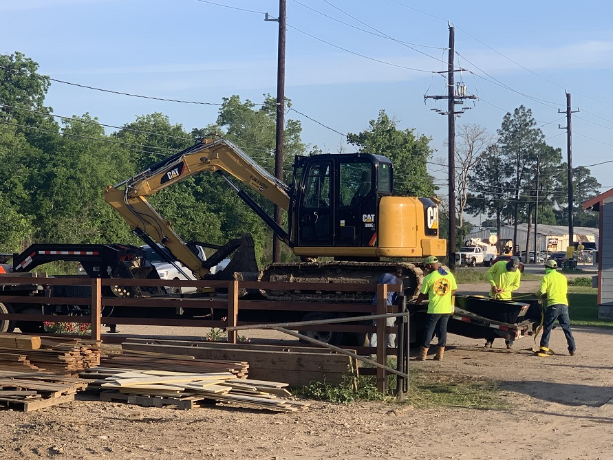 image of excavator being delivered